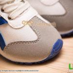 รองเท้าผ้าใบเด็กผูกเชือกสีขาวสไตล์สลิปออน